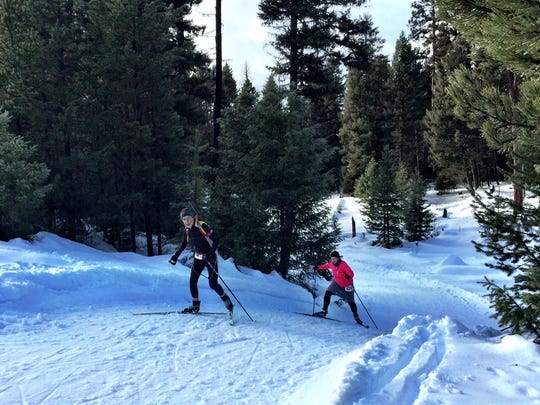 Racers climb up a hill during the Seeley Lake Challenge Biathlon.