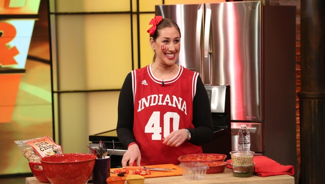 "Diehard IU fan Erica Sadowsky cooks a game day dip as she competes on the  ""Rachael Ray"" show for title of top NCAA fan."
