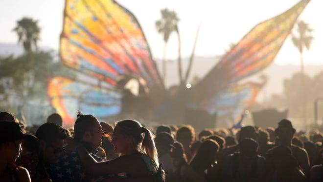 Fans dance to Madeon performance during the second Sunday of the 2015 Coachella Valley Music and Arts Festival in Indio.