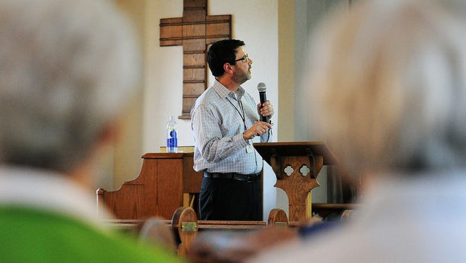 Joe Billig, senior vice president of architecture with Touchmark, speaks during a meeting for All Saints Neighborhood residents and property owners to learn about the Touchmark at All Saints expansion on Wednesday, April 22, 2015, in the Chapel at Touchmark at All Saints in Sioux Falls.