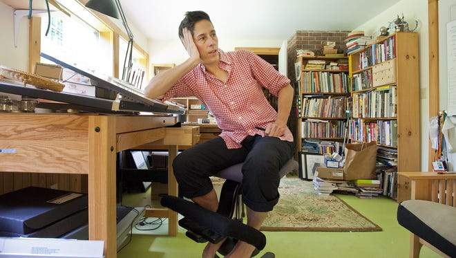 Cartoonist Alison Bechdel in her studio at home in Bolton on Monday August 6, 2012.