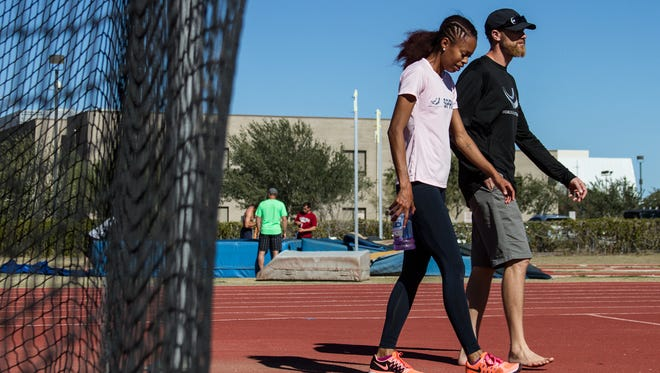 Two-time Olympian Muna Lee, left, is now training at World Athletics Center in Phoenix with coach Stuart McMillan. She will run in the 200-meter at U.S. Championships this week.