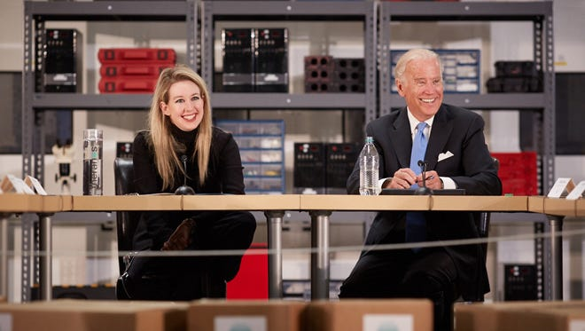 Theranos founder and CEO Elizabeth Holmes, left, recently welcomed Vice President Joe Biden to one of her blood work companies labs for a meeting on the future of healthcare.