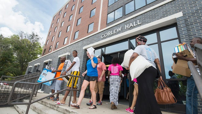 Middle Tennessee State University students move into Corlew Hall last August.