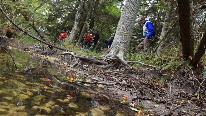 The Door County Land Trust hosted a guided trail hike through the Heins Creek Nature Preserve, 7112 Wisconsin 57, south of Baileys Harbor, on Saturday, Oct. 3, 2015.  Heins Creek, a Class 2 trout stream, meanders through a northern forest and sand dunes on the 74-acre property.  Tina M. Gohr/Your Key to the Door Weekly