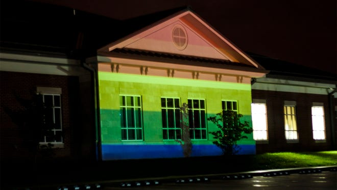 Student artist Michael Kopp documented his light projection on Rowan County Courthouse on Sept. 30. by