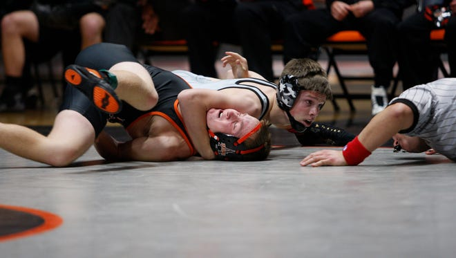 Ankeny Centennial's Zach Owens records a fall over Ames' Damon Cloutier in 1 minute 47 seconds in the 138-pound match during Thursday's season-opening dual meet at Ames. Owens' pin came in the final match of the night and sealed the Jaguars' 35-24 victory.