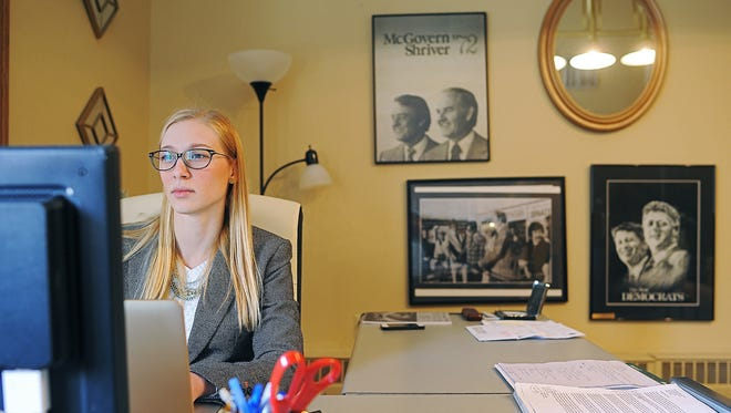 Suzanne Jones Pranger, executive director of the South Dakota Democratic Party, works at her desk in her office at the South Dakota Democratic Party offices Friday, Dec. 18, 2015, in downtown Sioux Falls.