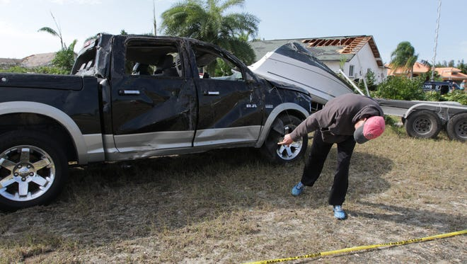 Cape Coral residents continued to re-build and clean-up in the aftermath of Saturday's EF2 tornado.   .