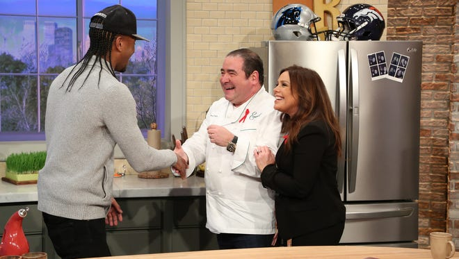 """Louisville chef Darnell Ferguson of SuperChefs greets celebrity chef Emeril Lagasse during the production of """"The Rachael Ray Show"""" in New York on Tuesday, Jan. 26, 2016. Photo: David M. Russell/Rachael Ray Show ©2016 King World Productions. All Rights Reserved."""