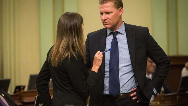 Republican Assembly members Kristin Olsen of Modesto and Chad Mayes of Yucca Valley, talk in September 2015 in Sacramento.