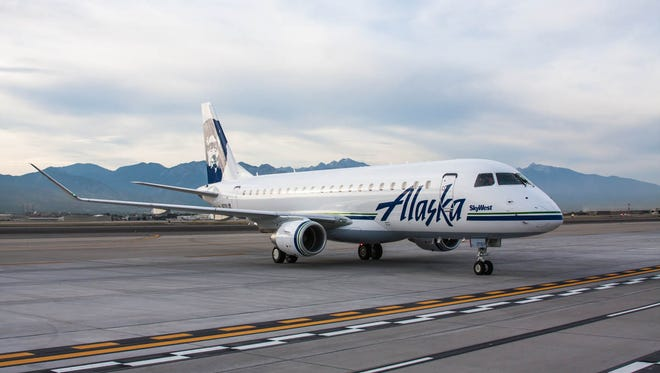 An image of an Embraer E175 painted in the colors of Alaska Airlines. This aircraft is operated by regional affiliate SkyWest.