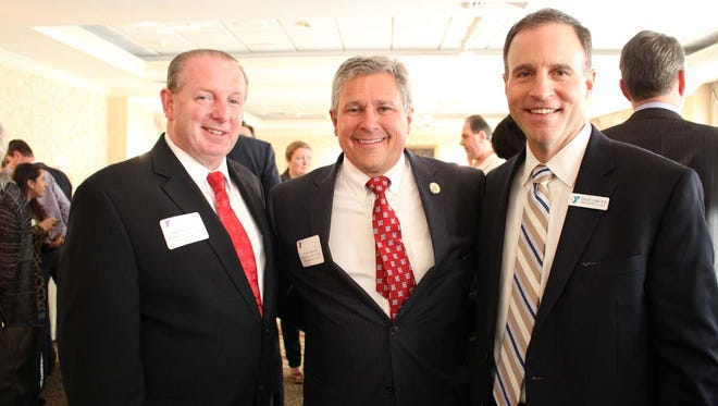 "Bernardsville Borough Mayor, Kevin Sooy, Somerset County YMCA President and CEO, David M. Carcieri, and Senator Christopher ""Kip"" Bateman of Somerville join together in support of the Y's cause to strengthen community."