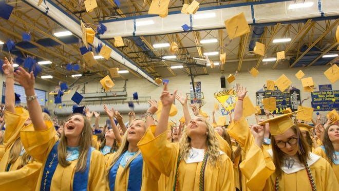 Kennard-Dale High School students celebrate their graduation with a commencement ceremony at the high school Friday, June 3, 2016.