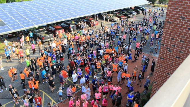 Racers gather at Hillsborough YMCA to warm up before the start of the Hop 5K to benefit the Y.