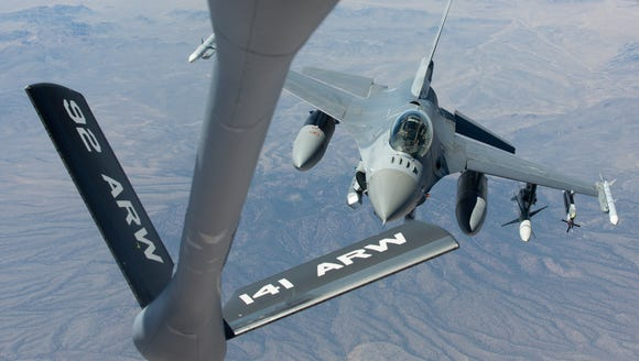An F-16 fighter jet  approaches the refueling boom