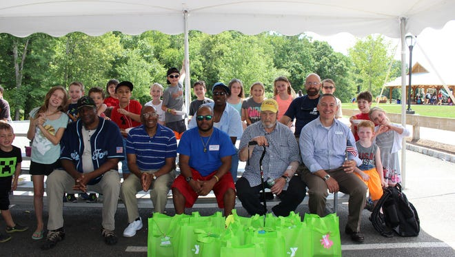 Somerset Hills YMCA's Day Camp hosted a pasta and ice cream lunch with local veterans and presented them with swimwear donated by camp families on Friday, Aug. 5.
