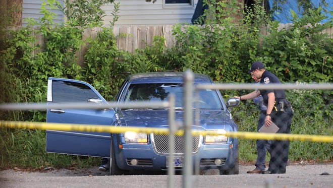 Police on the scene of double shooting in the Beechmont area.