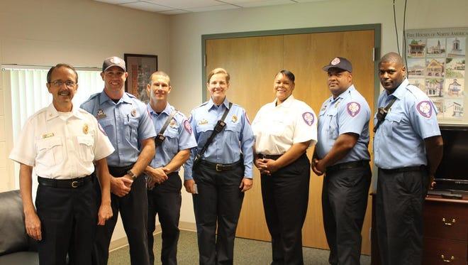 Left to right: Fire Chief David Allen, Lieutenant Kelly Akins, Captain Jed Martin, Battalion Chief Ginny Cranor, Fire Marshal Annie Bloxson, Captain Marquette Oliver and Battalion Chief Cedric King.