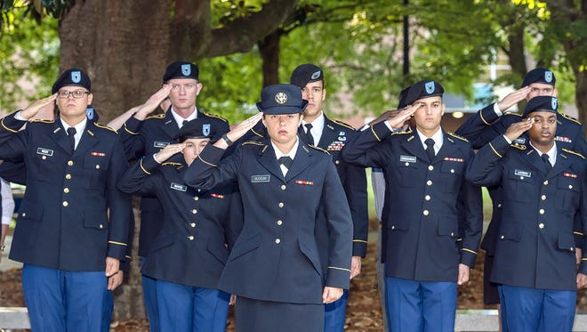 MTSU ROTC cadets salute during the playing of taps at the university's 9/11 Observance on the 14th anniversary of the deadly terrorist attacks on U.S. soil. The event was held in the MTSU Veterans Memorial in 2015. This year's observance will be Sunday, Sept. 11. The public is invited.