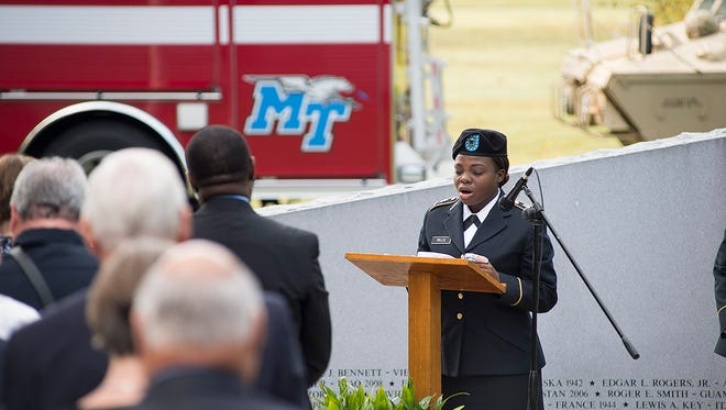 A prayer and moment of silence is led by Cadet Shanika Willis during MTSU's Observance Ceremony of 9/11.