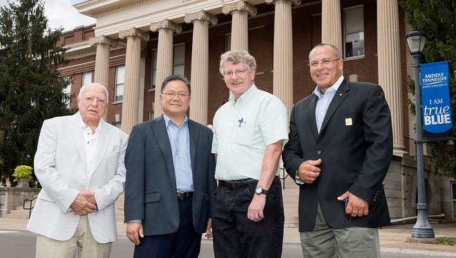 From left, Tecport Optics and MTSU representatives Frank Helmes, Tecport sales, Tecport President Tam Lee, physics and astronomy professor and inventor Bill Robertson and Tecport Vice Chairman Nabil El-Hag visit in front of Kirksey Old Main at MTSU. A licensing agreement between MTSU and Tecport will commercialize an innovative diagnostic tool invented by Robertson for medical research and health professionals. (MTSU photo by J. Intintoli)Nabil El-Hag, Vice Chair, Tecport Optics Inc, William Robertson, MTSU Physics Faculty, Tam Le, President, Tecport Optics Inc., and Frank Helmes, VP Tecportvision