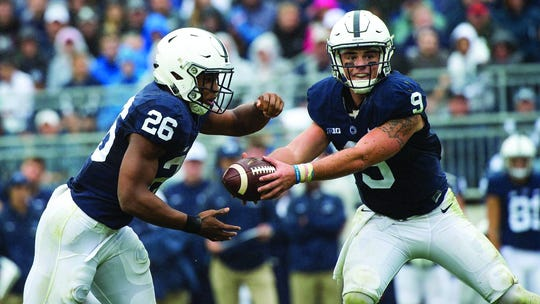 Penn State quarterback Trace McSorley, right, hands