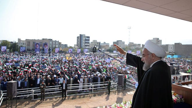 A handout picture made available by the official presidential website shows Iranian president Hassan Rouhani