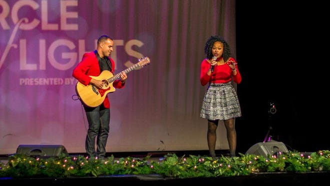 Linzi Rodgers performs with Broderick Thompson at Downtown Indy's Circle of Lights singing competition.