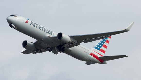 An American Airlines Boeing 767-300 departs London