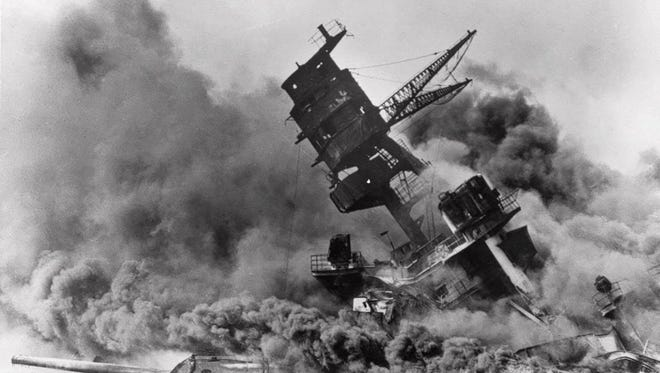 FILE - In this Dec. 7, 1941 file photo, smoke rises from the battleship USS Arizona as it sinks during a Japanese surprise attack on Pearl Harbor, Hawaii. Saturday marks the 72nd anniversary of the attack that brought the United States into World War II. (AP File Photo) ORG XMIT: NYSB725