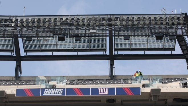 Solar panels were installed in 2012 around the top of MetLife Stadium in east Rutherford, N.J. The panels are the large grids above the lights.