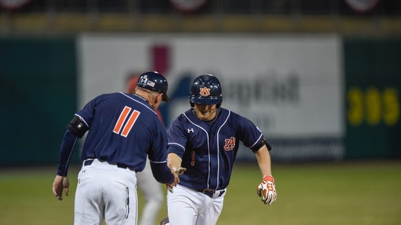 Auburn catcher Blake Logan, show here after a home run in the 2016 Capital City Classic in Montgomery against Alabama, is expected to return fully healthy for the opening weekend of the 2017 season.