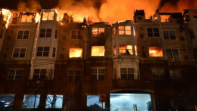 Flames consume the Avalon at Edgewater apartment complex on Jan. 21, 2015.