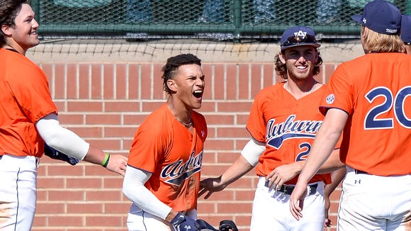 Will Holland celebrates his first career home run in a 13-4 win over Holy Cross on Feb. 26, 2017.
