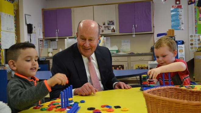 PNC Bank Market Executive Bruce Colbourn plays with students at New Castle County Head Start, Inc.'s Marshallton center on April 4, 2017.