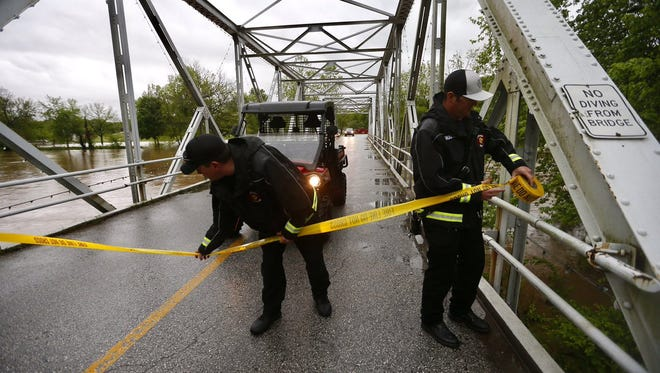 Ozark firefighters shut down the Finley River Bridge to pedestrian traffic.
