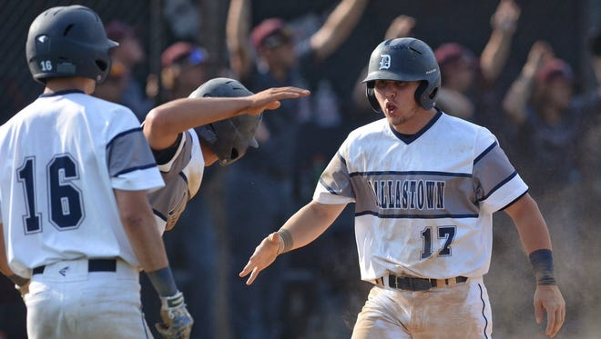 Dallastown's Tracy Carr (17) celebrates after scoring a run during Dallastown's 6-1 win over State College on Monday. The Wildcats fell one game short of bringing home the program's first ever state title, but transformed a program along the way.