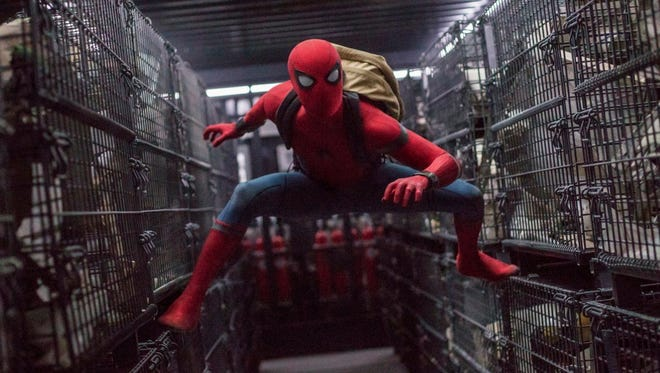 "Tom Holland is your friendly neighborhood teenage Spider-Man (note the backpack) in ""Spider-Man: Homecoming."""