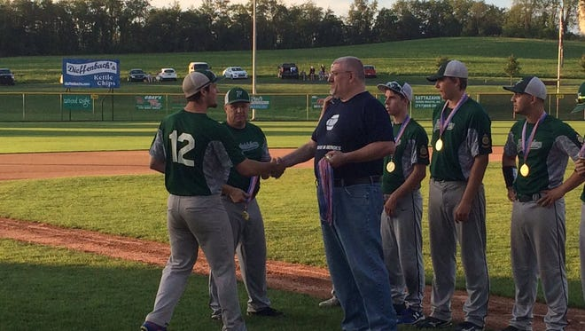 Isaac Wengert (12) and his Fredericksburg Legion baseball teammates received their Lebanon County regular season championship medals prior to Friday night's playoff opener vs. Conrad Weiser. Fredericksburg won the game, 10-1.