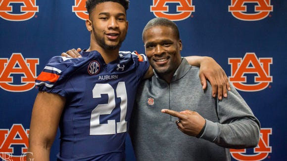 Four-star 2018 Georgia linebacker Michael Harris poses for a picture with Auburn linebackers coach Travis Williams during a recruiting visit.