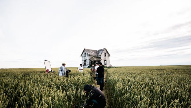 """A film crew captures the Blake Reid Band recording in an abandoned house in the movie """"No Roads In,"""" one of the featured documentaries in the Scruffy City Film & Music Festival."""