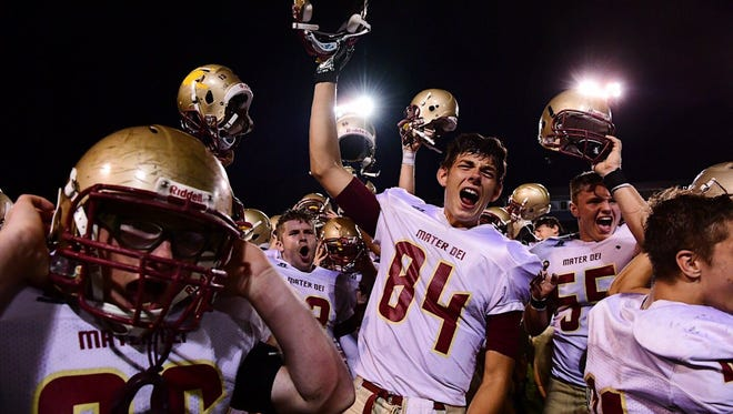 Mater Dei players celebrate after defeating Castle 31-30 Friday night at John Lidy Field.