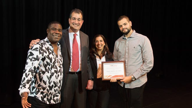 From left: Tracy Morgan with Dr. Brian Greenwald, Dr. Sara Cuccurullo and Juan G. Ramirez