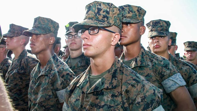 Lukas Brockway and his fellow platoon members during the Eagle, Globe and Anchor ceremony, where they were officially declared U.S. Marines on Sept. 16, 2017.