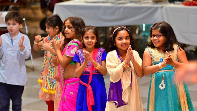 Children celebrate at a Diwali gala in New Jersey. The Indian Society of Central Wisconsin will bring a Diwali event to the Rothschild Pavilion.