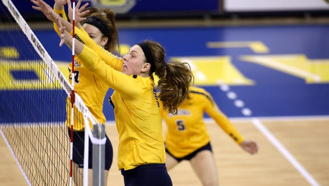 Allie Barber attempts a block at the net at the Al McGuire Center for the Marquette women's volleyball team.