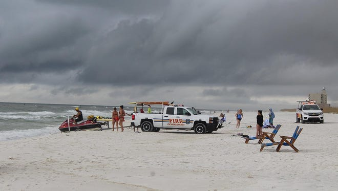 A father and two of his daughters were rescued from Pensacola Beach after being caught in a rip current.