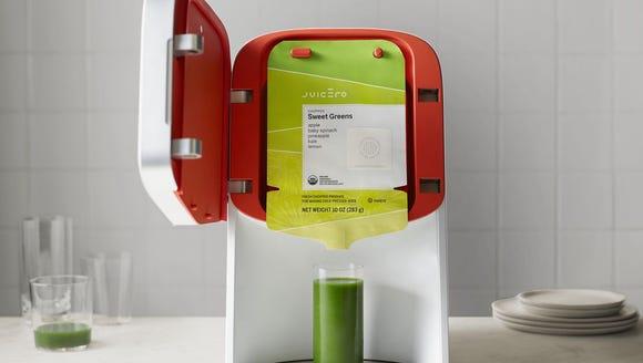 The now defunct $400 Juicero Press machine,