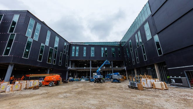 The Mike Ilitch School of Business at Wayne State University is halfway complete.